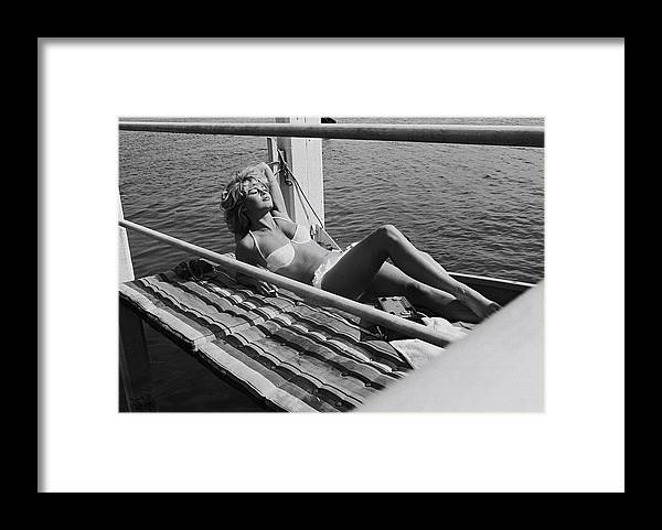 Brigitte Bardot Framed Print featuring the photograph Brigitte Bardot Sur Le Tournage De Vie by Giancarlo Botti