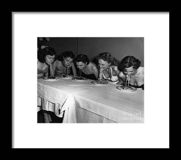 Event Framed Print featuring the photograph Broadway Showgirls Eating Spaghetti by Bettmann