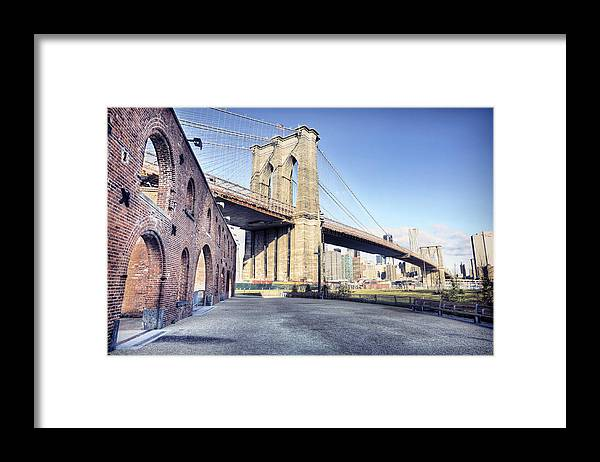 Lower Manhattan Framed Print featuring the photograph Brooklyn Bridge From Down Under by By Gene Krasko