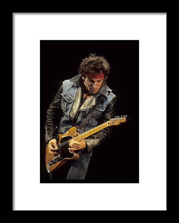 Bruce Springsteen Framed Print featuring the photograph Bruce Springsteen Performs Live by Richard Mccaffrey