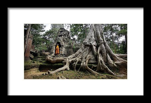 Orange Color Framed Print featuring the photograph Buddhist Monk At Angkor Wat Temple by Timothy Allen