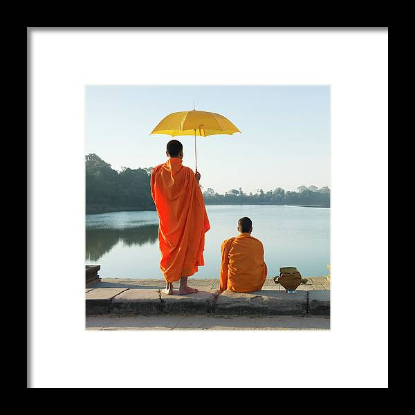Young Men Framed Print featuring the photograph Buddhist Monks Standing In Front Of by Martin Puddy