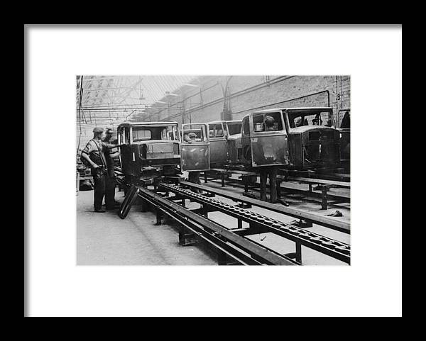 1930-1939 Framed Print featuring the photograph Building Cars by Fox Photos
