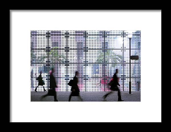 People Framed Print featuring the photograph Business People Passing Modern Office by Eschcollection