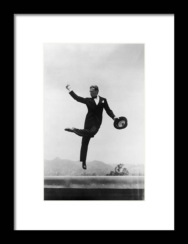 Wind Framed Print featuring the photograph Cagney Leaping In Formal Attire by Getty Images