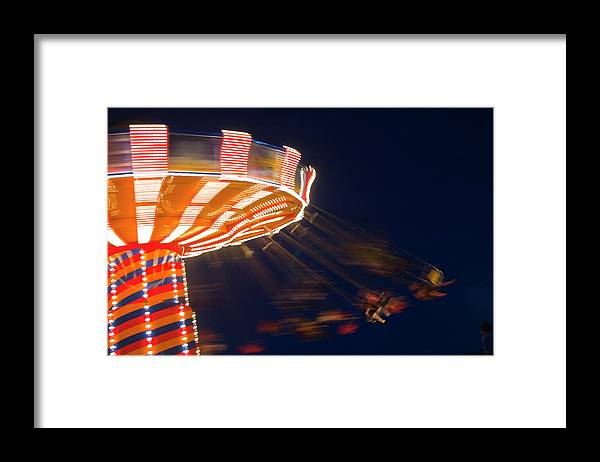 Blurred Motion Framed Print featuring the photograph Carnival Ride by By Ken Ilio