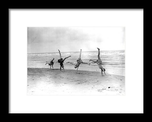 People Framed Print featuring the photograph Cartwheels by Fox Photos
