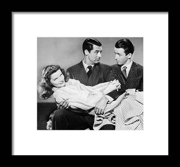 Jimmy Stewart Framed Print featuring the photograph Cary Grant, James Stewart by Bettmann