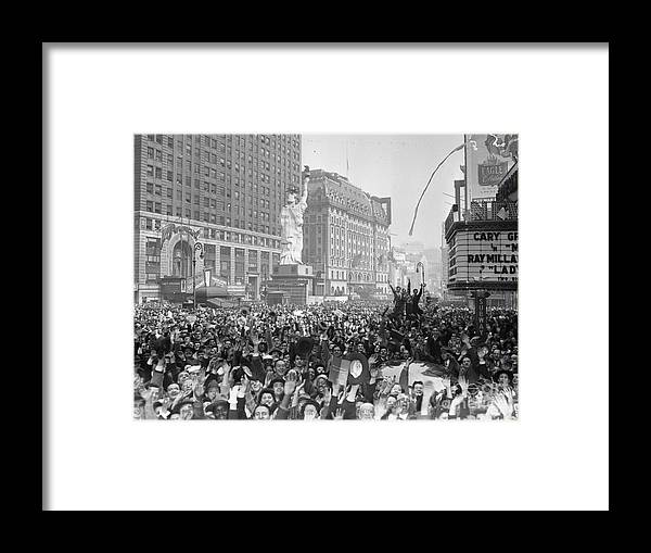 Crowd Of People Framed Print featuring the photograph Celebrants In Times Square On V-e Day by Bettmann