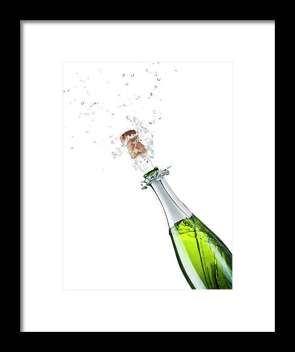Releasing Framed Print featuring the photograph Champagne Bottle by Mphillips007
