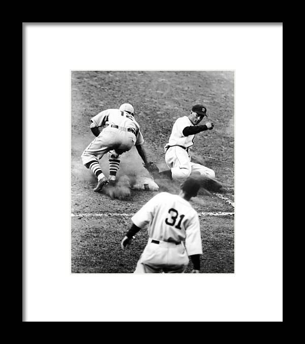 St. Louis Cardinals Framed Print featuring the photograph Charlie Gehringer Slides Into First Base by Fpg