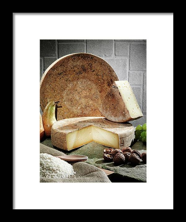 Fontina Framed Print featuring the photograph Cheese, Fruit And Grains On Table by Walter Zerla
