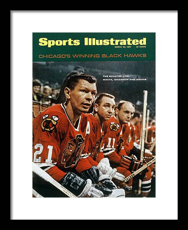 National Hockey League Framed Print featuring the photograph Chicago Blackhawks Stan Mikita, Kenny Wharram, And Doug Sports Illustrated Cover by Sports Illustrated