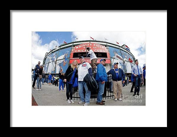 American League Baseball Framed Print featuring the photograph Chicago Cubs Fans Watch Game Four In by Jon Durr