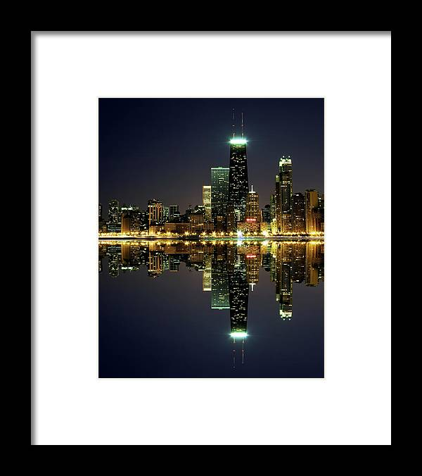 Lake Michigan Framed Print featuring the photograph Chicago Skyline Reflected On Lake by Pawel.gaul