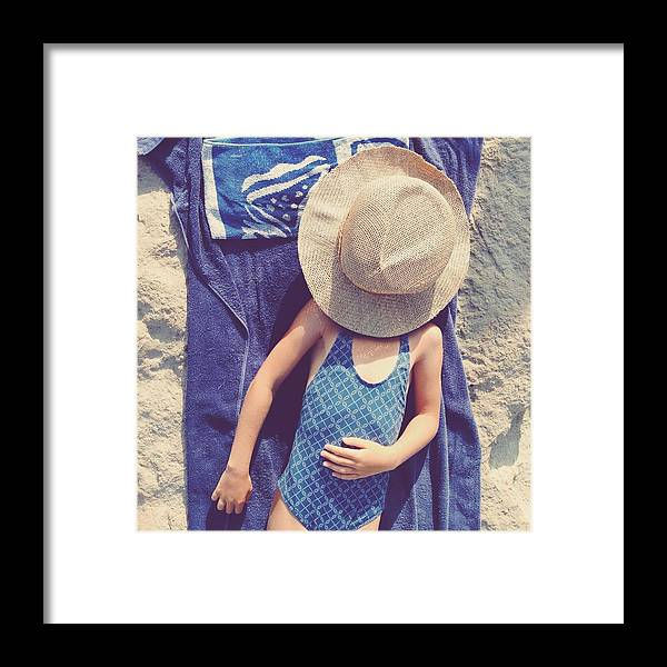 4-5 Years Framed Print featuring the photograph Child In Swimsuit Laying On Towel With by Jodie Griggs