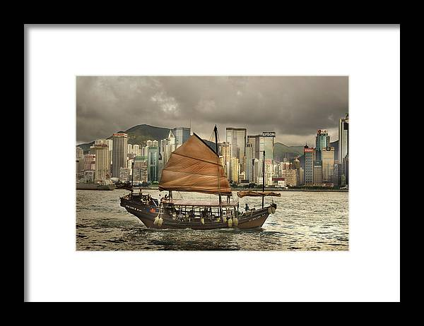 Sailboat Framed Print featuring the photograph China, Hong Kong, Junk Boat In Bay by Maremagnum