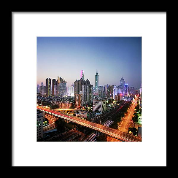 Corporate Business Framed Print featuring the photograph China, Shenzen Skyline At Dusk by Martin Puddy