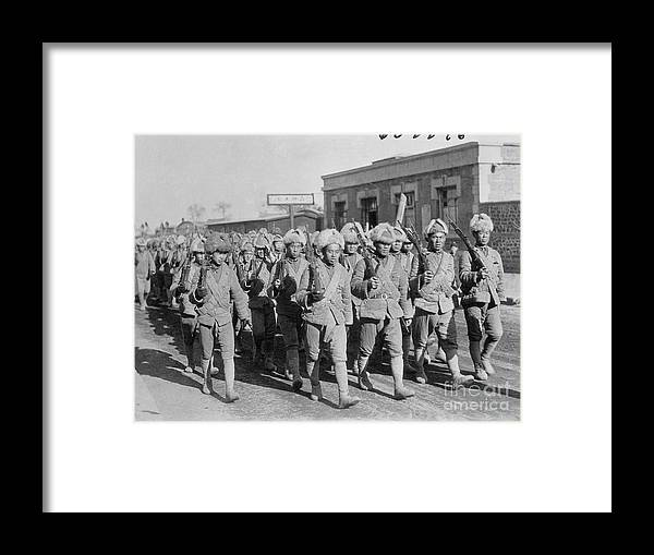 Marching Framed Print featuring the photograph Chinese Soldiers Marching With Weapons by Bettmann