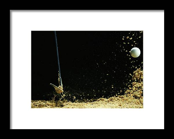Sand Trap Framed Print featuring the photograph Chipping A Golf Ball Out Of Sand On A by Kolbz
