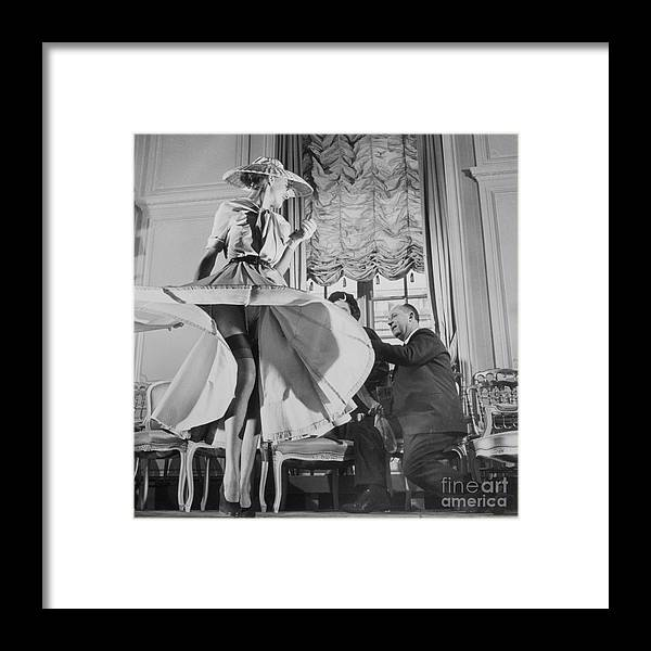 People Framed Print featuring the photograph Christian Dior With Woman Modeling by Bettmann