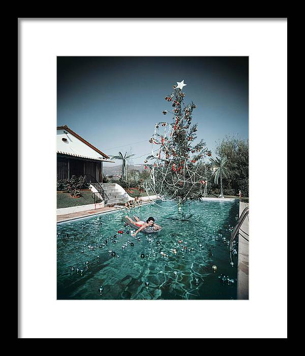 People Framed Print featuring the photograph Christmas Swim by Slim Aarons
