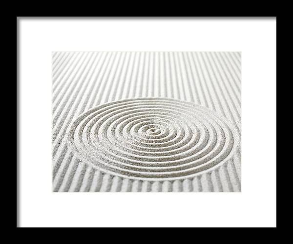In A Row Framed Print featuring the photograph Circles And Lines In Sand by Wragg