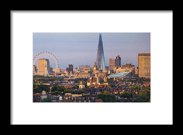 Tranquility Framed Print featuring the photograph City Skyline In Late Evening Sunlight by Simon Butterworth