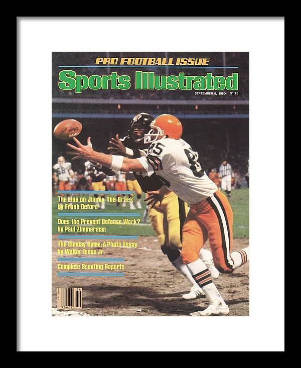 Catching Framed Print featuring the photograph Cleveland Browns Dave Logan And Pittsburgh Steelers Mel Sports Illustrated Cover by Sports Illustrated