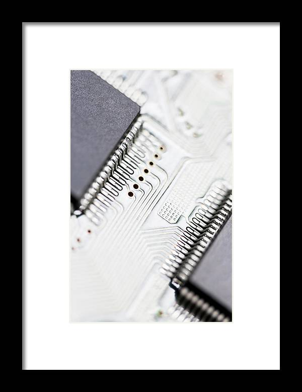 Electrical Component Framed Print featuring the photograph Close-up Of A Circuit Board by Nicholas Rigg