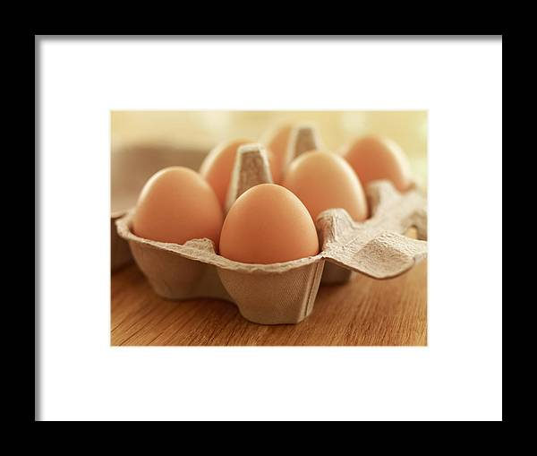 Free Range Framed Print featuring the photograph Close Up Of Brown Eggs In Carton by Adam Gault