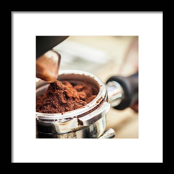 Mature Adult Framed Print featuring the photograph Close Up Of Espresso Grounds In Machine by Manuel Sulzer