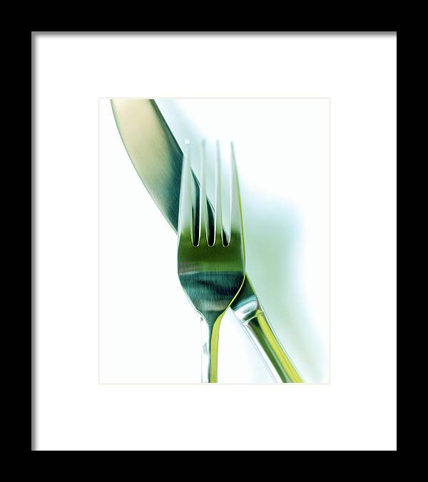 Empty Framed Print featuring the photograph Close-up Of Fork And Knife On White by Amy Neunsinger