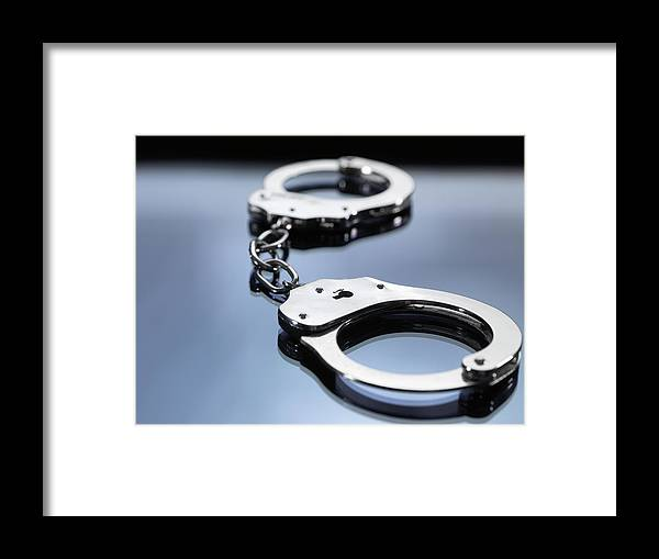 Punishment Framed Print featuring the photograph Close Up Of Metal Handcuffs by Andrew Brookes