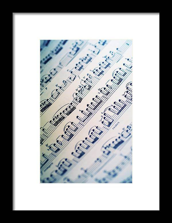 Sheet Music Framed Print featuring the photograph Close-up Of Sheet Music by Medioimages/photodisc