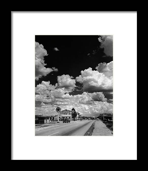 Timeincown Framed Print featuring the photograph Clouds Over Seligman by Andreas Feininger