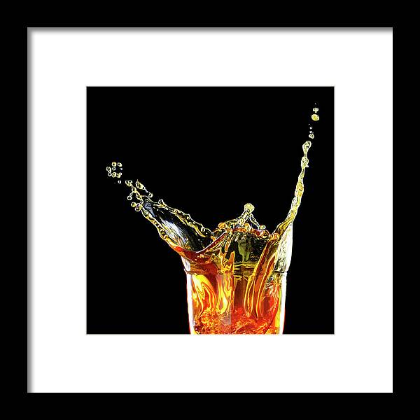 Alcohol Framed Print featuring the photograph Cocktail With Big Splash In A Tumbler by Chris Stein