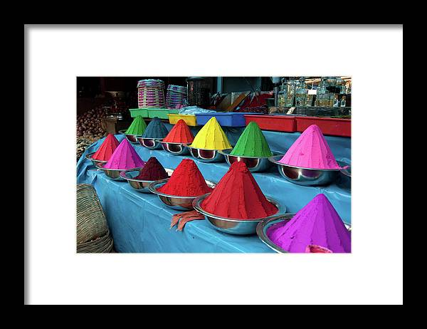 In A Row Framed Print featuring the photograph Colorful Dyes At Indian Market by Photo By Meredith Narrowe