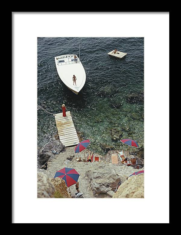 People Framed Print featuring the photograph Coming Ashore by Slim Aarons