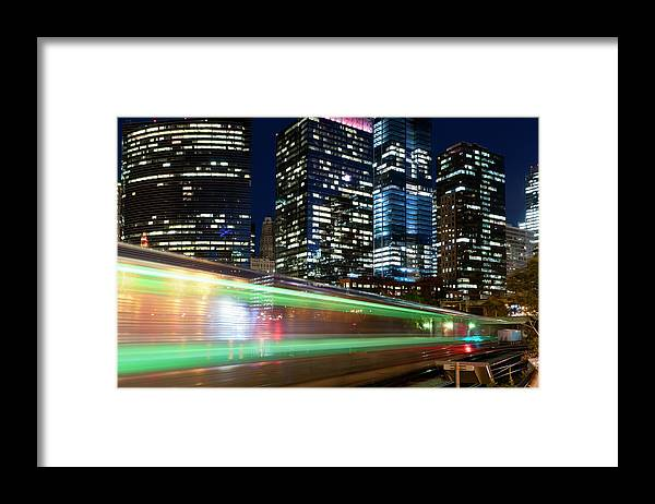 Passenger Train Framed Print featuring the photograph Commuter Train In Downtown Chicago by Chrisp0