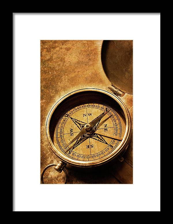 East Framed Print featuring the photograph Compass On Old Texture by Dny59