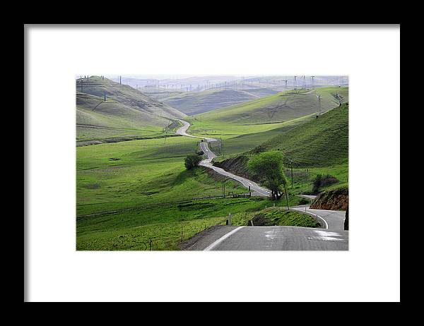 Scenics Framed Print featuring the photograph Country Road Through Green Hills by Mitch Diamond