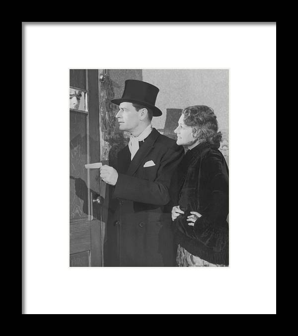 Young Men Framed Print featuring the photograph Couple In Formal Wear Showing Pass To by Fpg