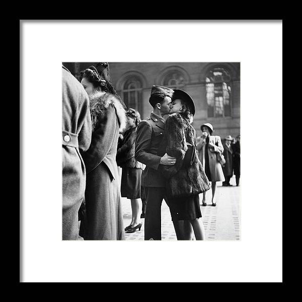 Timeincown Framed Print featuring the photograph Couple In Penn Station Sharing Farewell by Alfred Eisenstaedt