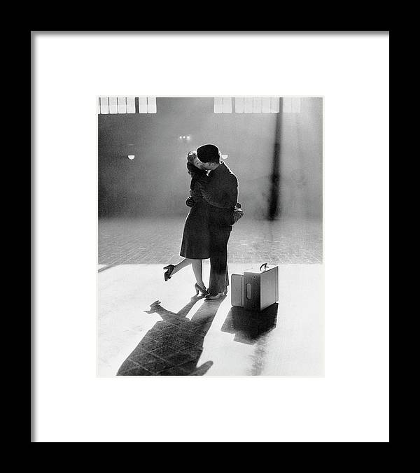 Shadow Framed Print featuring the photograph Couple Kissing In Train Station by Bettmann