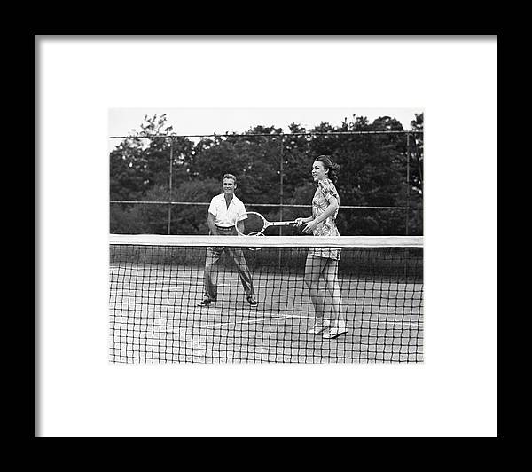 Heterosexual Couple Framed Print featuring the photograph Couple Playing Tennis by George Marks