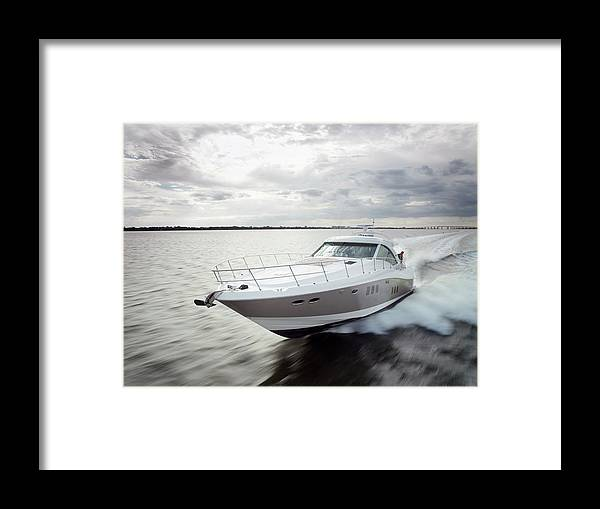 Wake Framed Print featuring the photograph Couple Relaxing On Speed Boat, Dawn by Gary John Norman