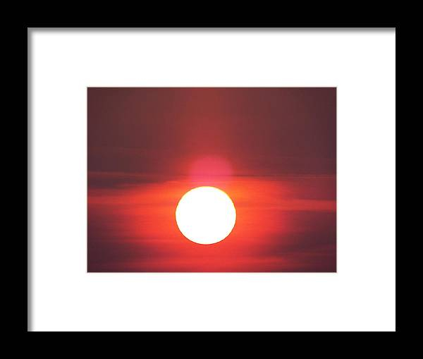 Framed Print featuring the photograph Crimson Sun by James Harris