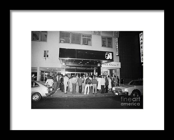 Crowd Of People Framed Print featuring the photograph Crowd Standing In Front Of Studio 54 by Bettmann