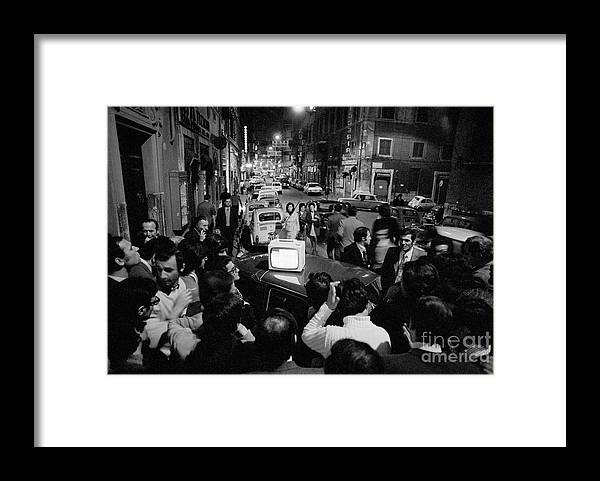 Crowd Of People Framed Print featuring the photograph Crowd Watching Election Results On Tv by Bettmann